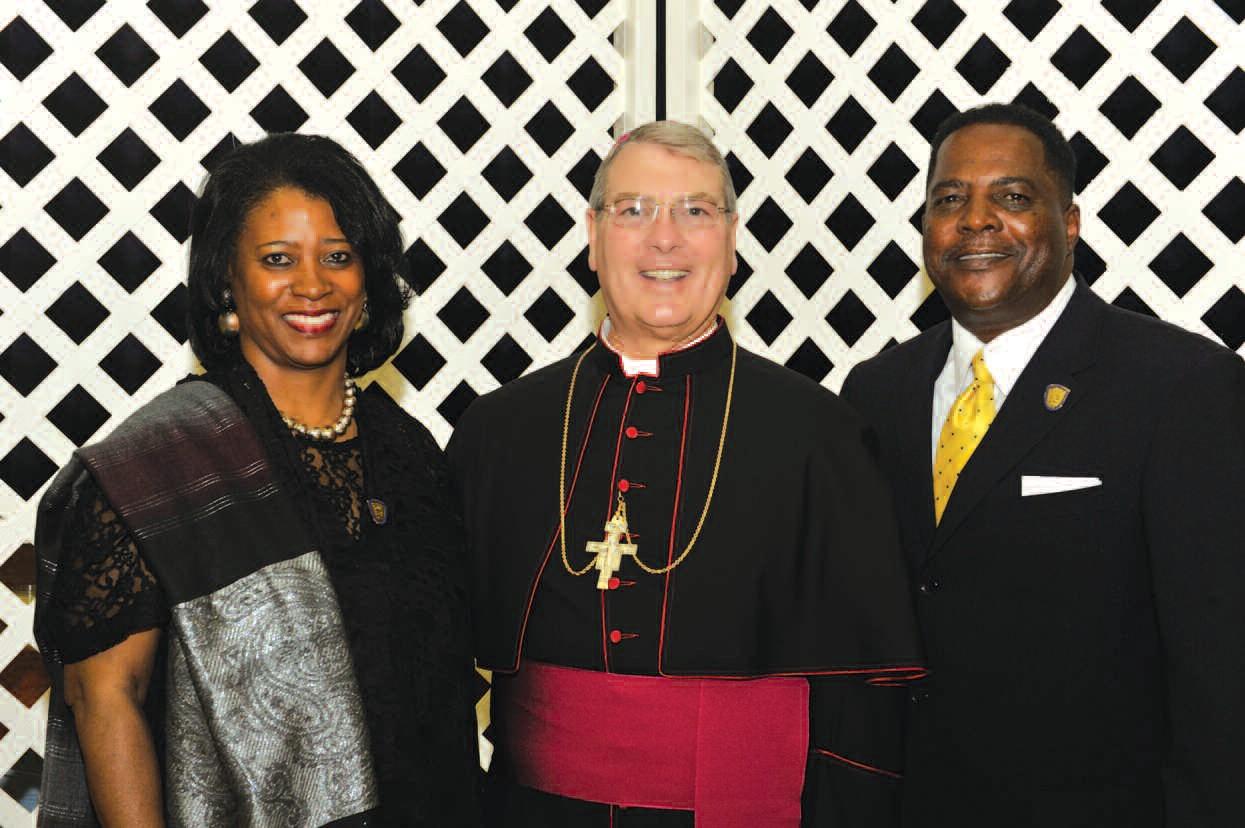Cheryl Eady, Bishop Gregory J. Hartmayer and Greg Eady