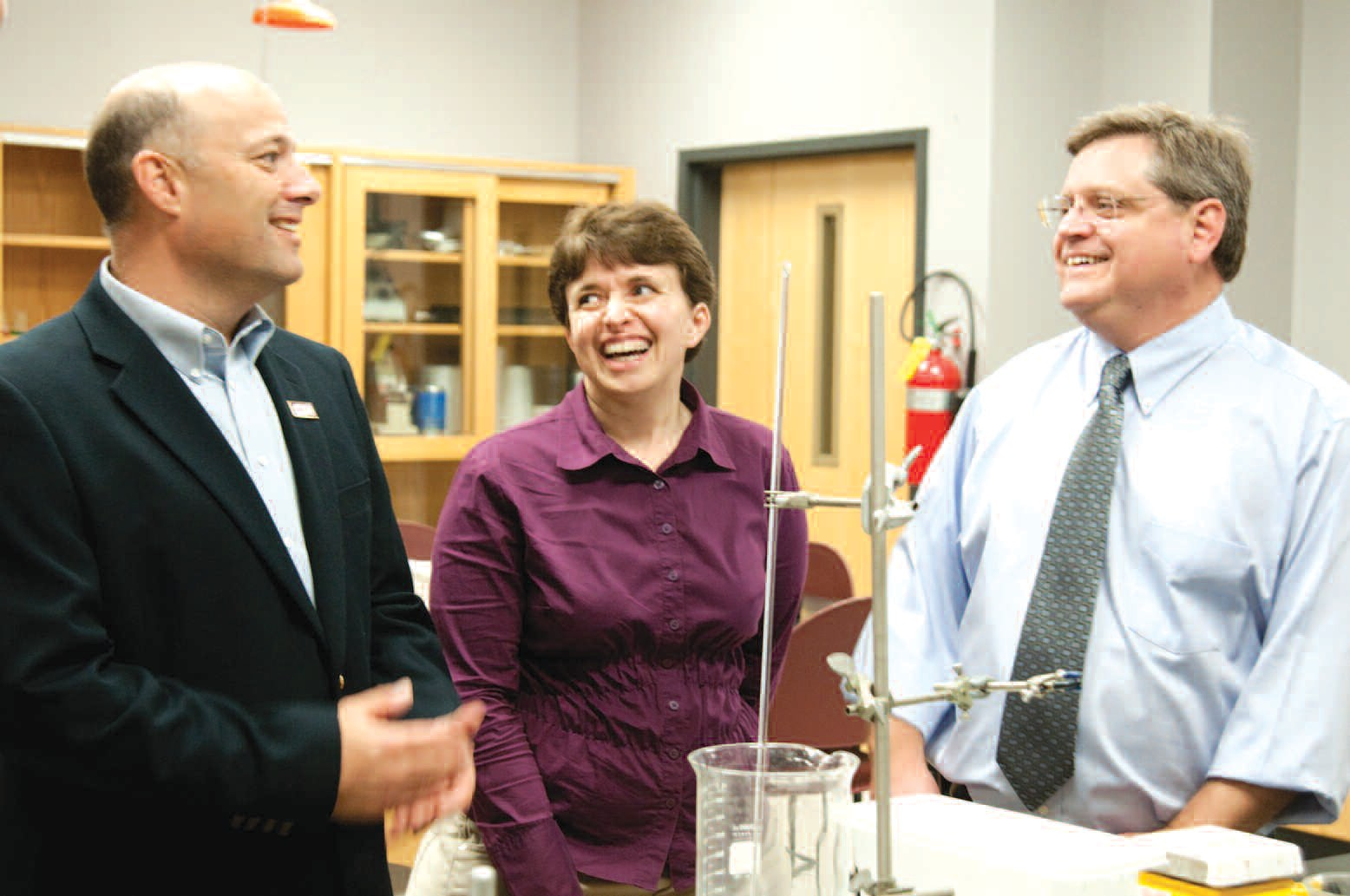 Siemens' Account Manager John Petrillo and Branch Manager Tracy Colwell tour Armstrong's Science Center with Professor Donna Mullenax.