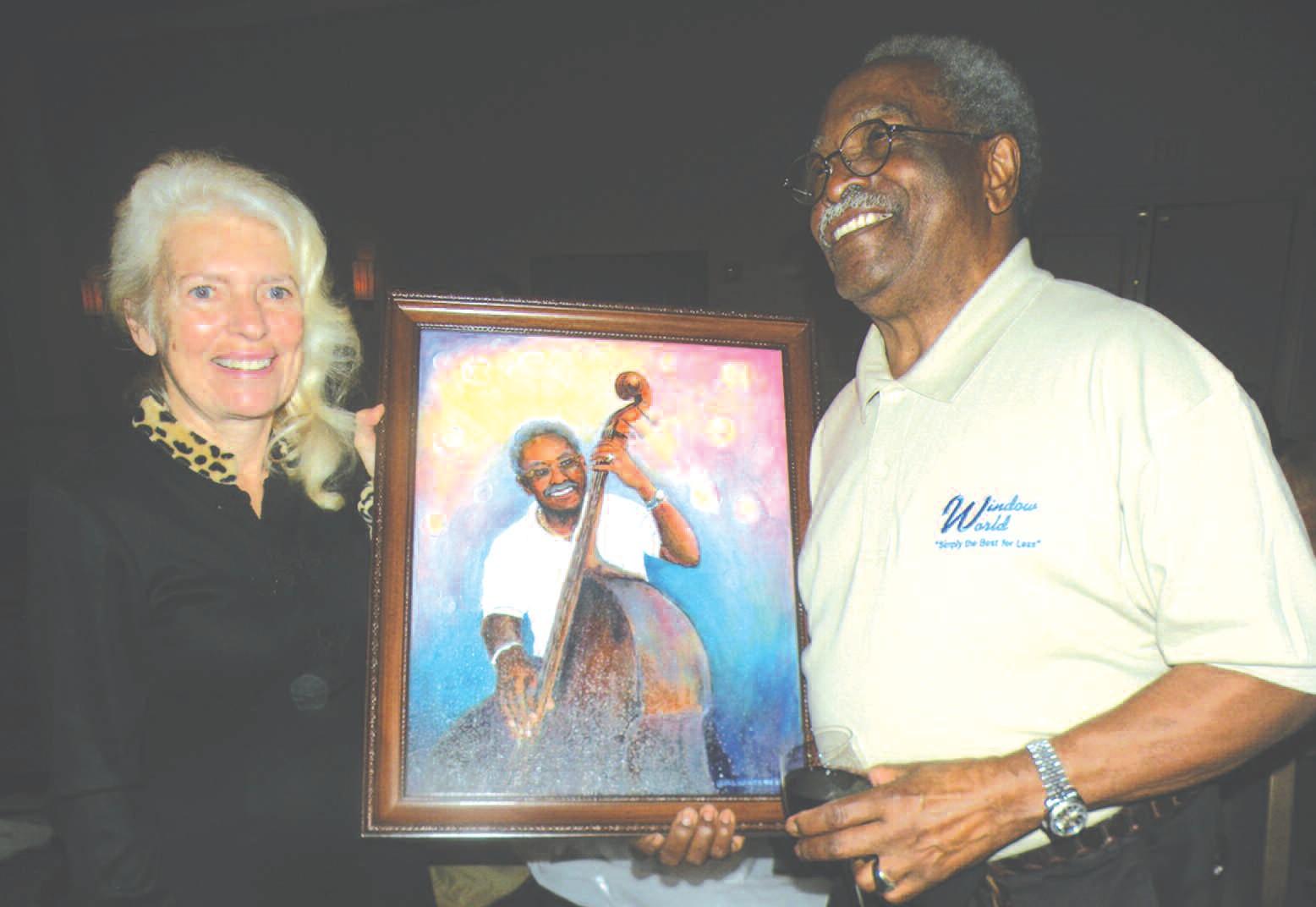 MaryLou Vandenburg presents painting to jazz legend Ben Tucker