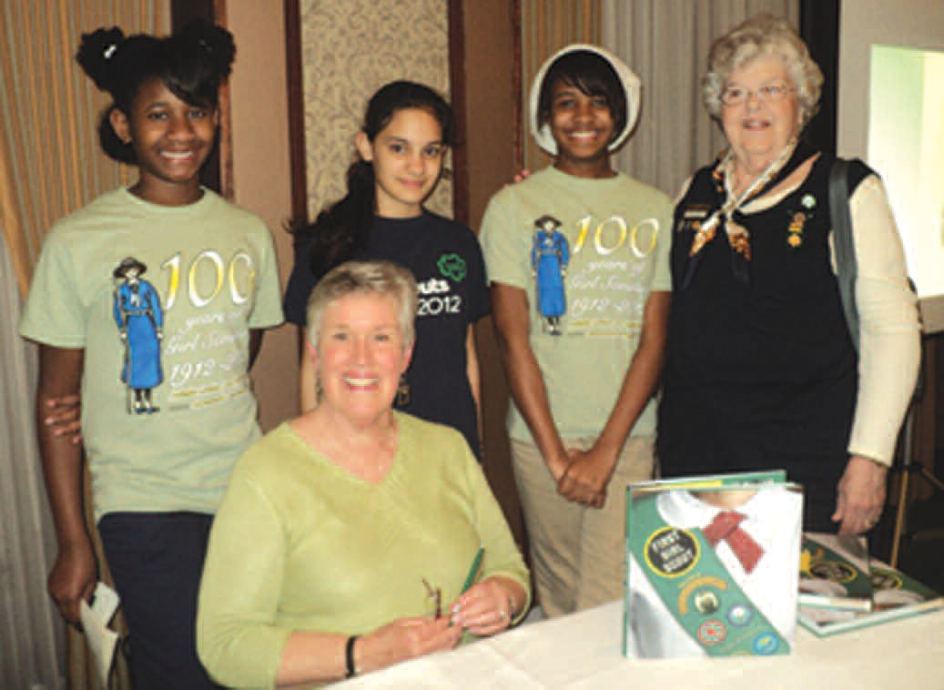 L-R : Camille Clovis, Rachel Crawford, AlexziaClovis, and leader Harriet Cobb, along with author Ginger Wadsworth(seated).