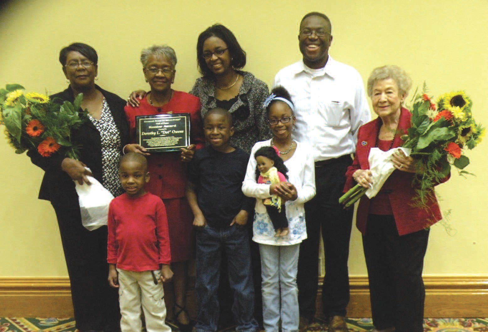 Dot Owens (second from left) pictured with daughter, son-in-law, sister, grandchildren, and Mrs. Harriet Konter (right).