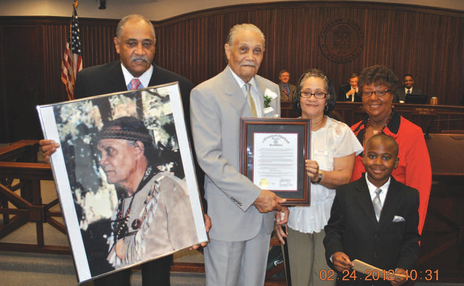 Commissioner Thomas presents proclamation honoring Deacon Rufus Peters as the First African American Tomochichi in recognition of Black History Month. (Commissioner Priscilla Thomas was assisted by Jakari Flowers)