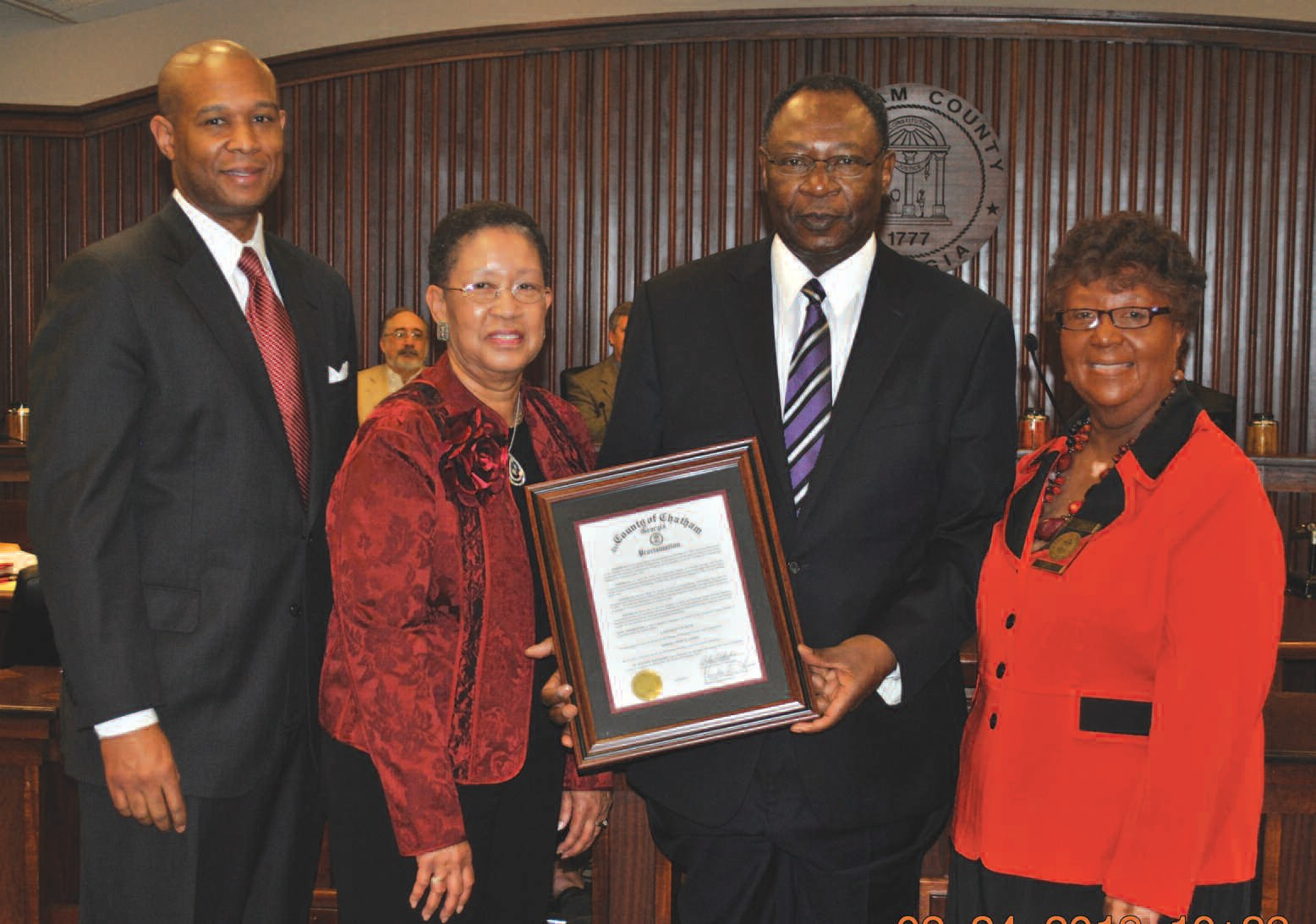 Commissioner Thomas presents proclamation congratulating Carver State Bank on its 85th Anniversary and Mr. Robert