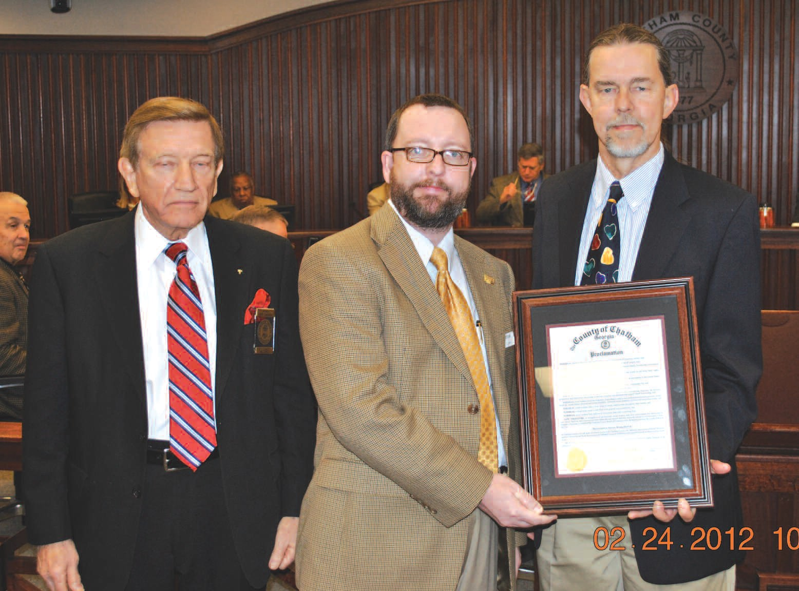 Chairman Pete Liakasis presents proclamation declaring March 2012 as