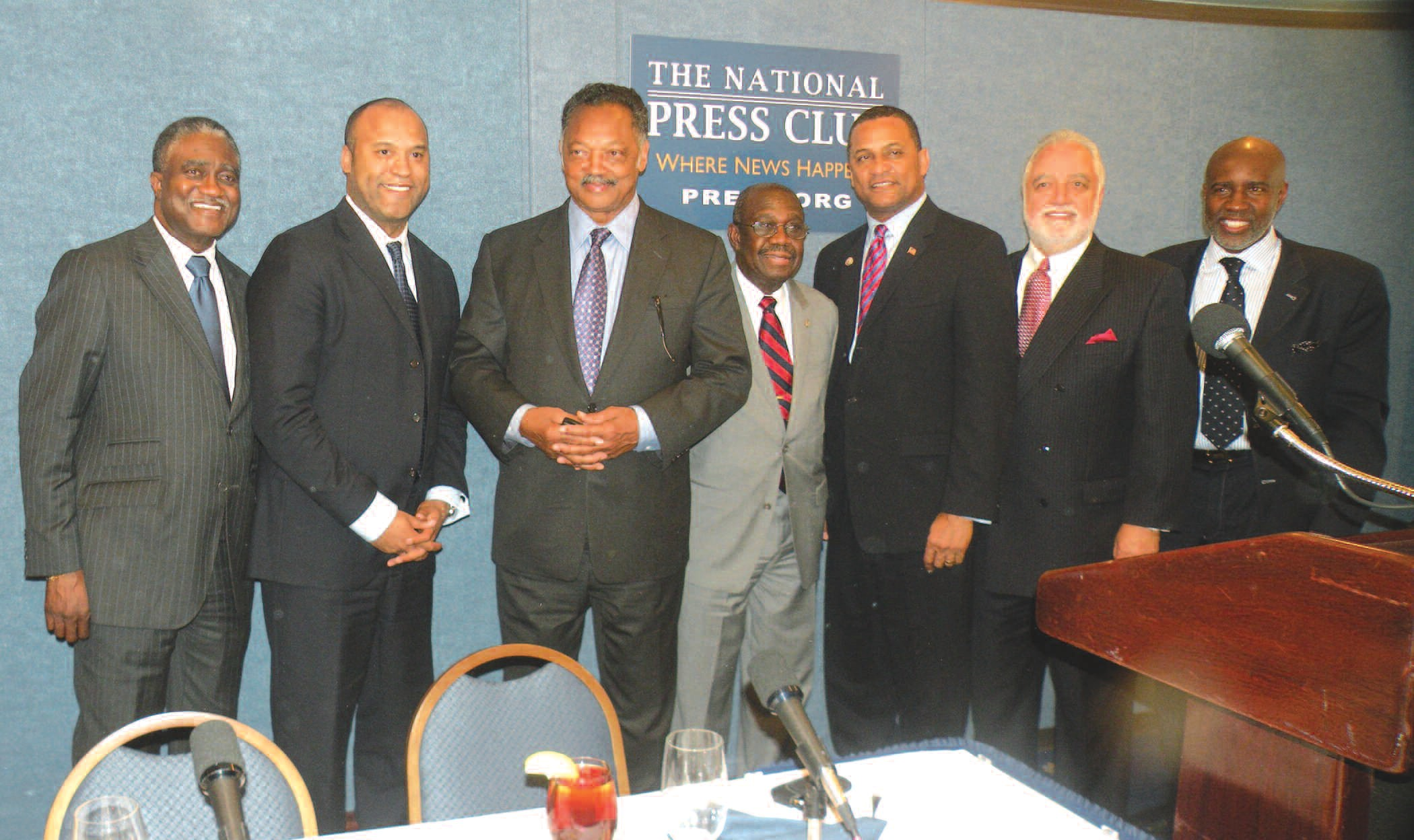 L-R: George Curry, Londell McMillan, Rev. Jesse Jackson, Karl Rodney, Cloves Campbell, Danny Bakewell and Len Burnette