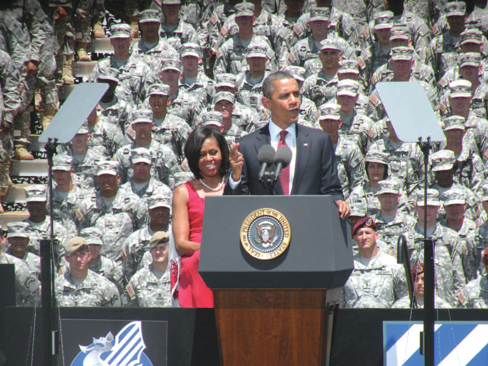 President Barack Obama and First Lady Michelle Obama address the troops