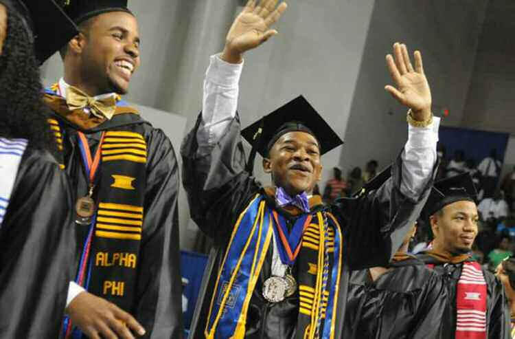 John Hudson Jr., a marketing graduate from Marietta, waves to relatives and friends during Savannah State University's Commencement on Saturday. Photo by Carl Elmore