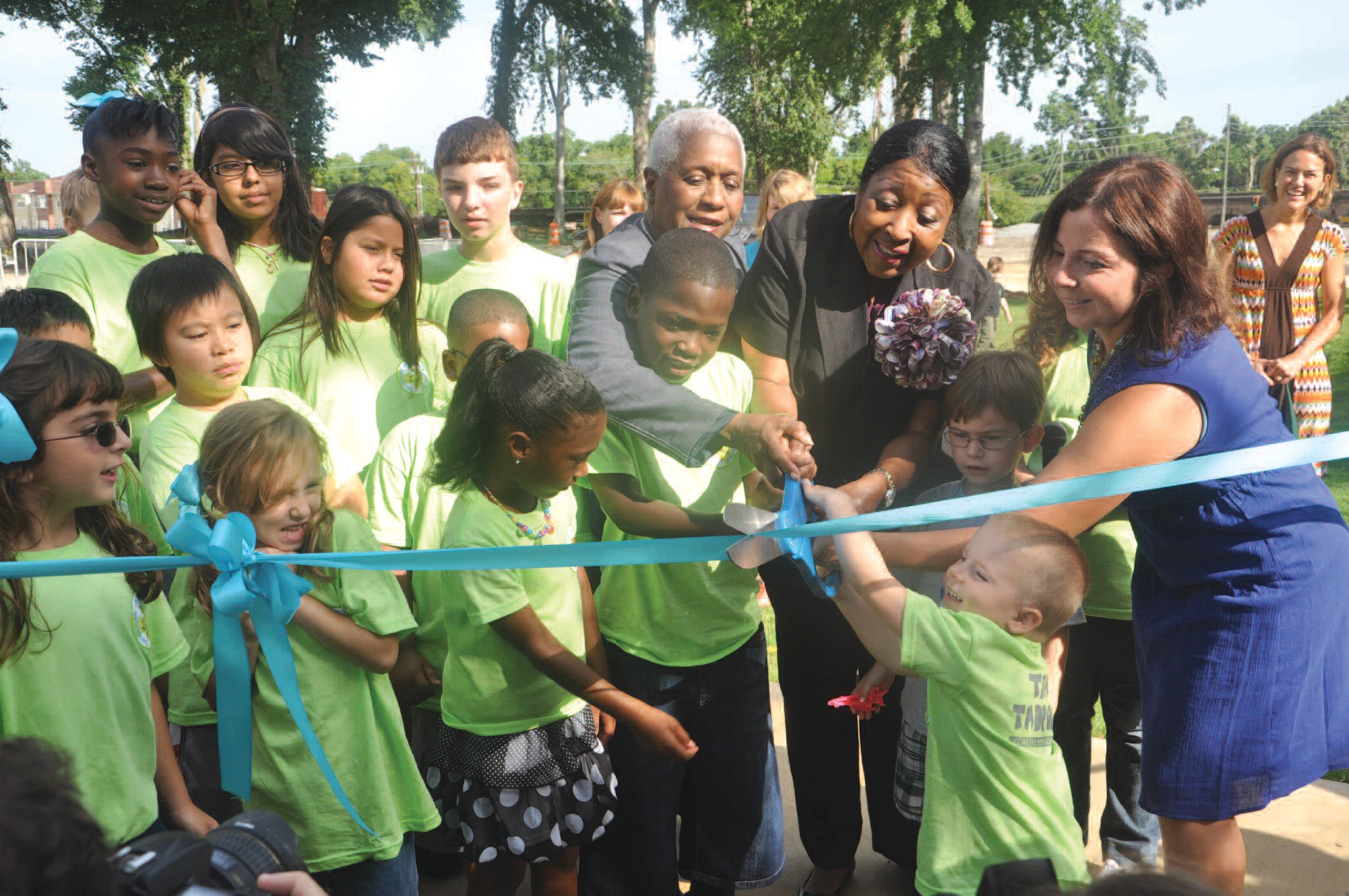 Photo by Arminta Hairston: Mary Osborne, Alderwoman for District 2, Mayor Edna Jackson and Patricia Knight, director of marketing and public relations for the Savannah Children's Museum participate in ribbon cutting with kids