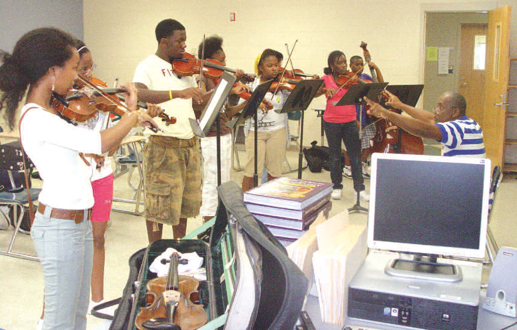 Mr. Felix Farrar instructs string students at BRAVO Camp 2011