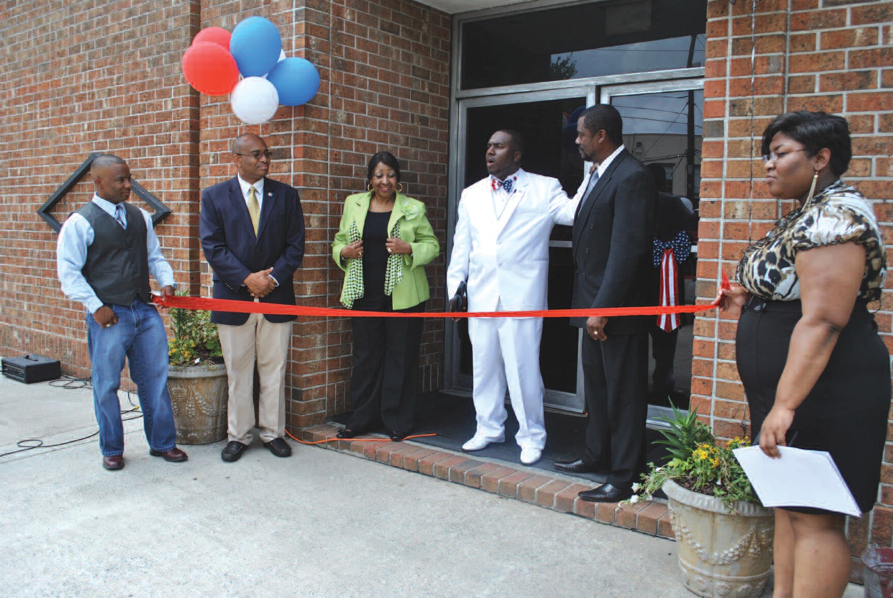 CEO and Founder Herbert Goodwin shown with Mayor Jackson and others at ribbon-cutting ceremony