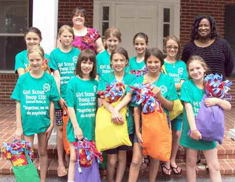 Greenbriar executive director Gena Taylor with Girl Scout Troop