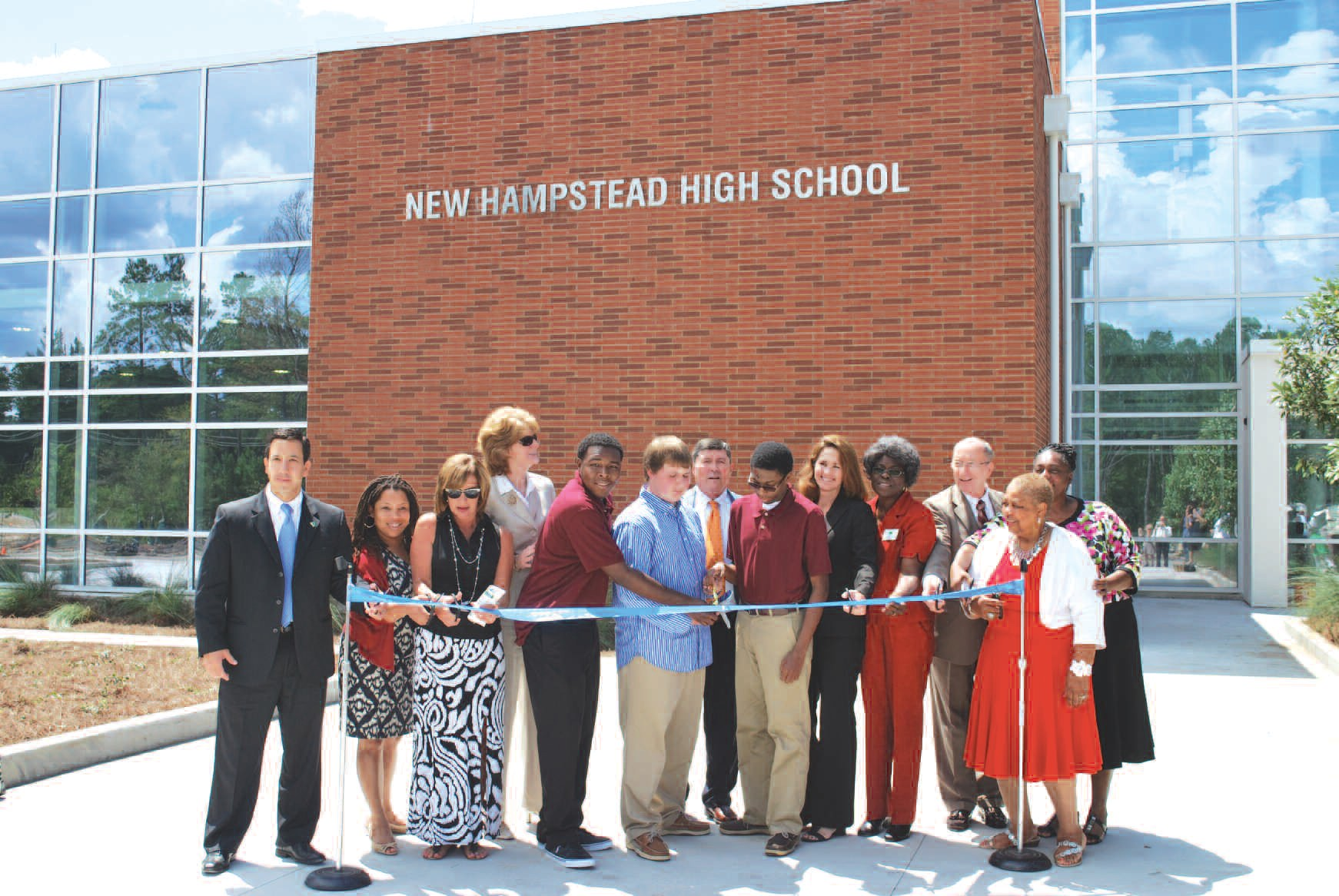 Members of the public, SCCPSS Administration, and members of the Savannah- Chatham County Board of Public Education participate in ribbon cutting