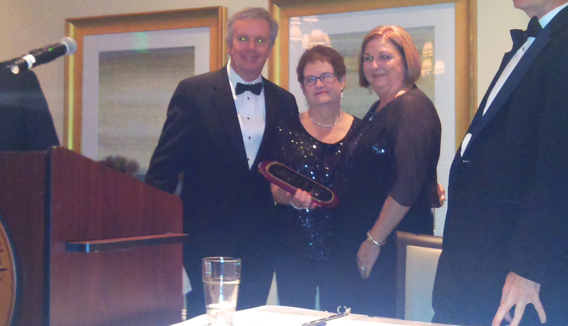 Lamar Smith (left) and Paula Mobley (center) present Hall of Fame Award to Elizabeth Williams Holley.