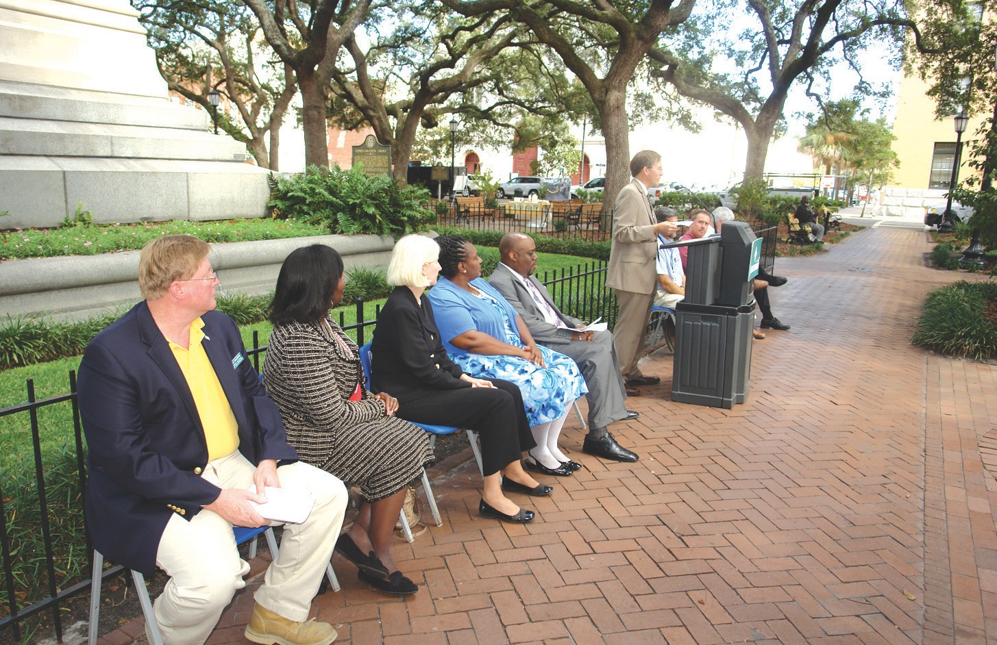 Park and Tree Commission Chairman Walt Harper, Post 1 At-Large Alderman Carolyn H. Bell, District 4 Alderman Mary Ellen Sprague, District 5 Alderman Estella E. Shabazz and Mayor Pro-tem Van R. Johnson look on as Park and Tree Director Jerry Flemming welcomes attendees to Tuesday's makeover celebration in Wright Square.