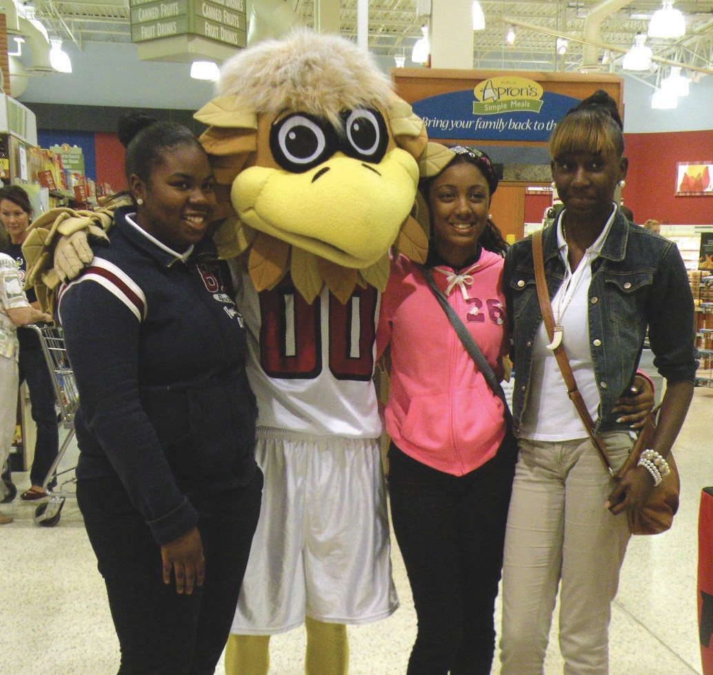 Locals pose with Freddie the Falcon