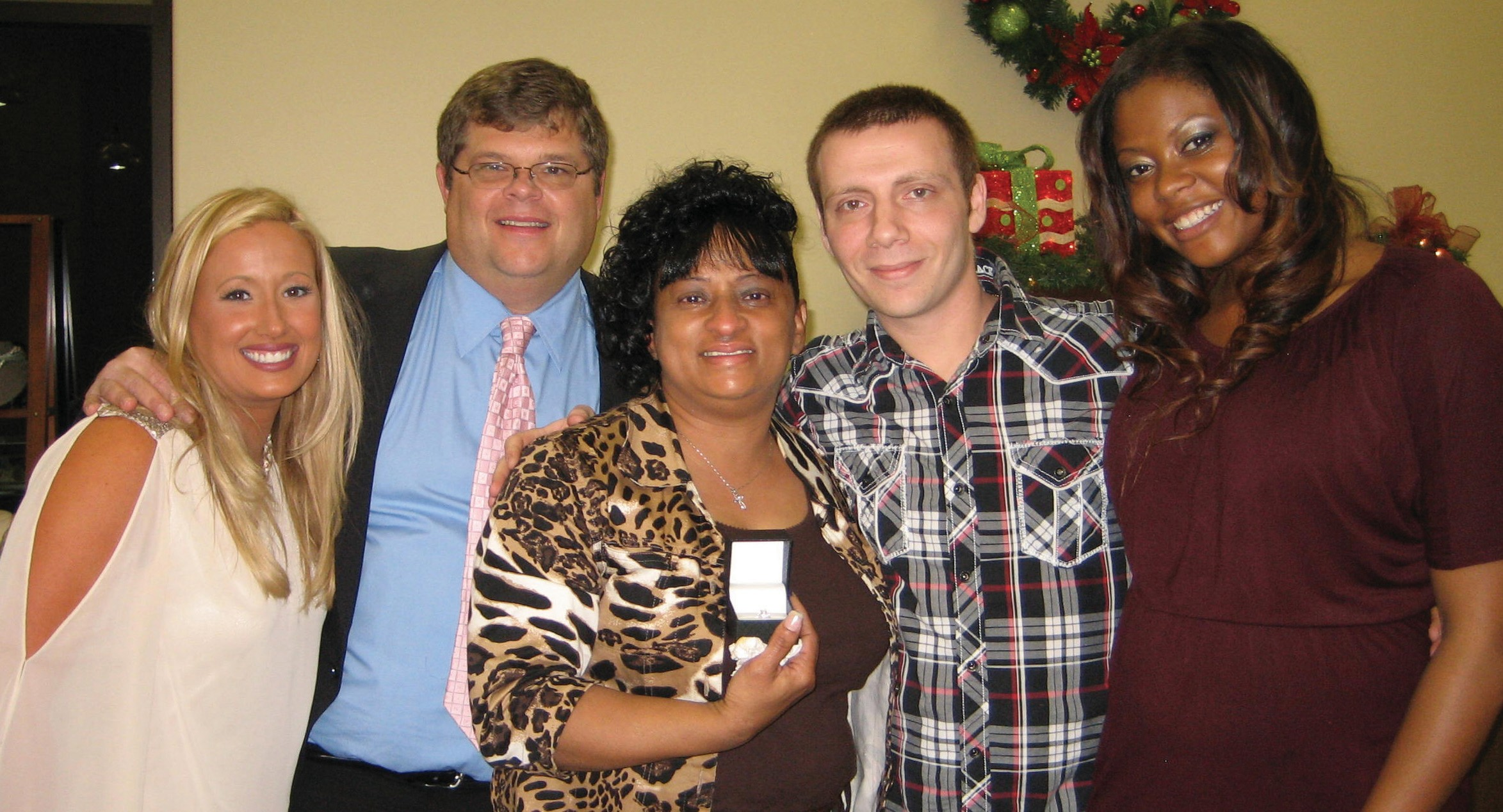 From left, Jenna and Marion Harkleroad, owners of Harkleroad Diamonds & Fine Jewelry, with Patricia Brantley, and Alessandro Griffith and spouse.