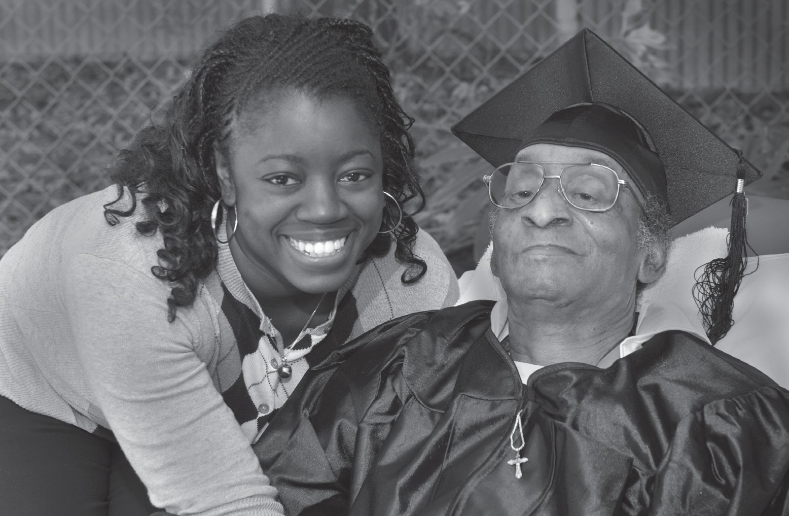 "Hospice of Savannah patient ""graduating"" out of care because the hospice him feel much better, he is pictured with his daughter who teaches at Savannah State."