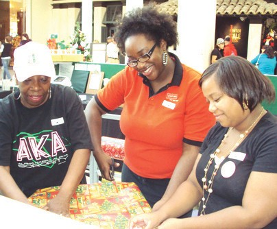 Volunteers wrapping holiday gifts for Greenbriar Children Center