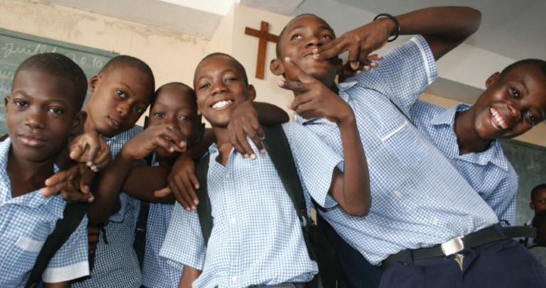 Students in Haiti pose for picture.