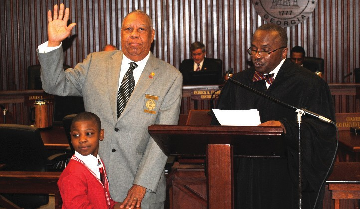 Commissioner James J. Holmes, District 2, sworn in by The Honorable Judge James F. Bass, Jr.