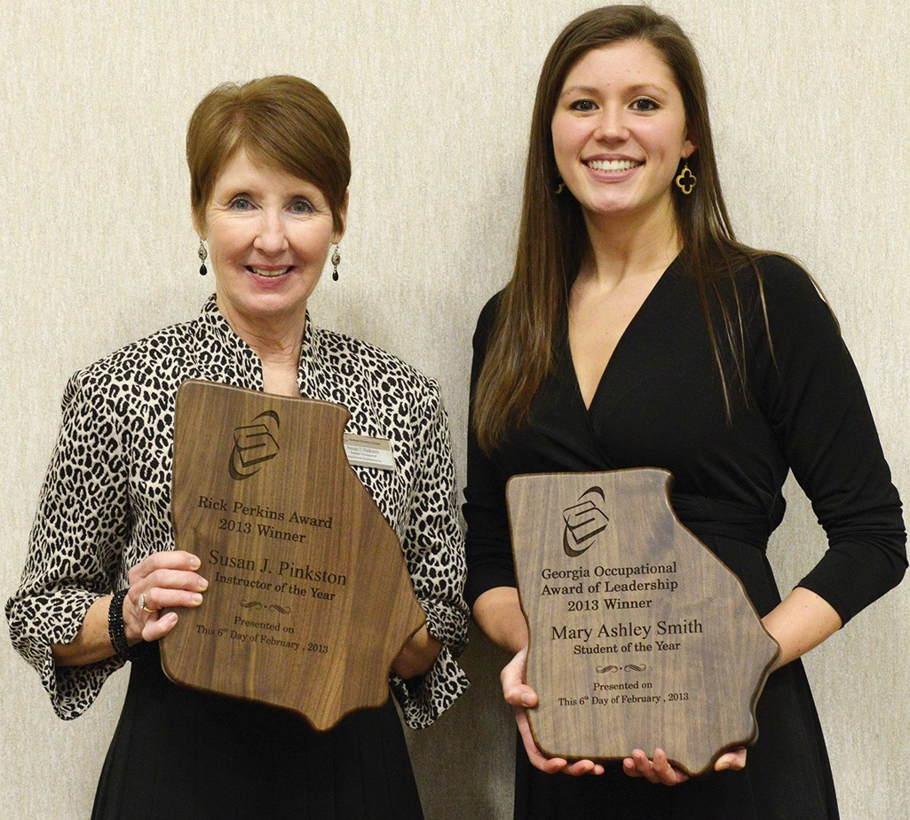 Susan Pinkston, STC department head for business management (left), and Ashley Smith, dental hygiene student (right), were honored by Savannah Technical College as its Instructor and Student of the Year for 2013.