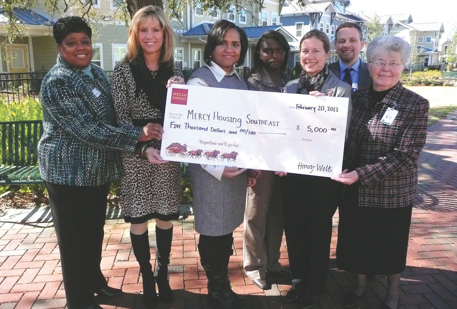 From left to right: Sheri Butler, Jenny Gentry and Connie Bryant with Wells Fargo; Rachel Cunningham, Gray Nolan and Shawn Smitley with Mercy Housing Southeast; and Sister Margaret Beatty with St. Joseph's/Candler.