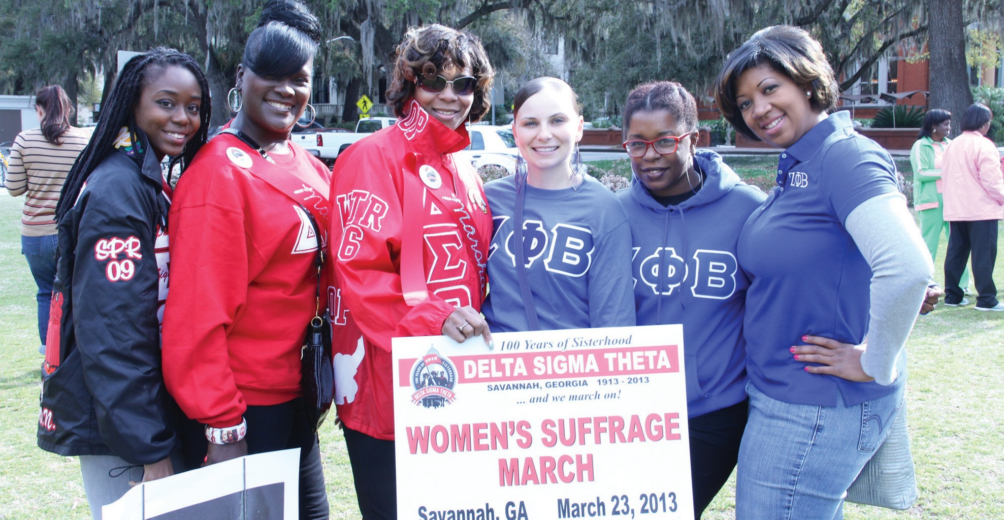 Young women participating in the Re-Enactment of the 1913 Women's Suffrage March.