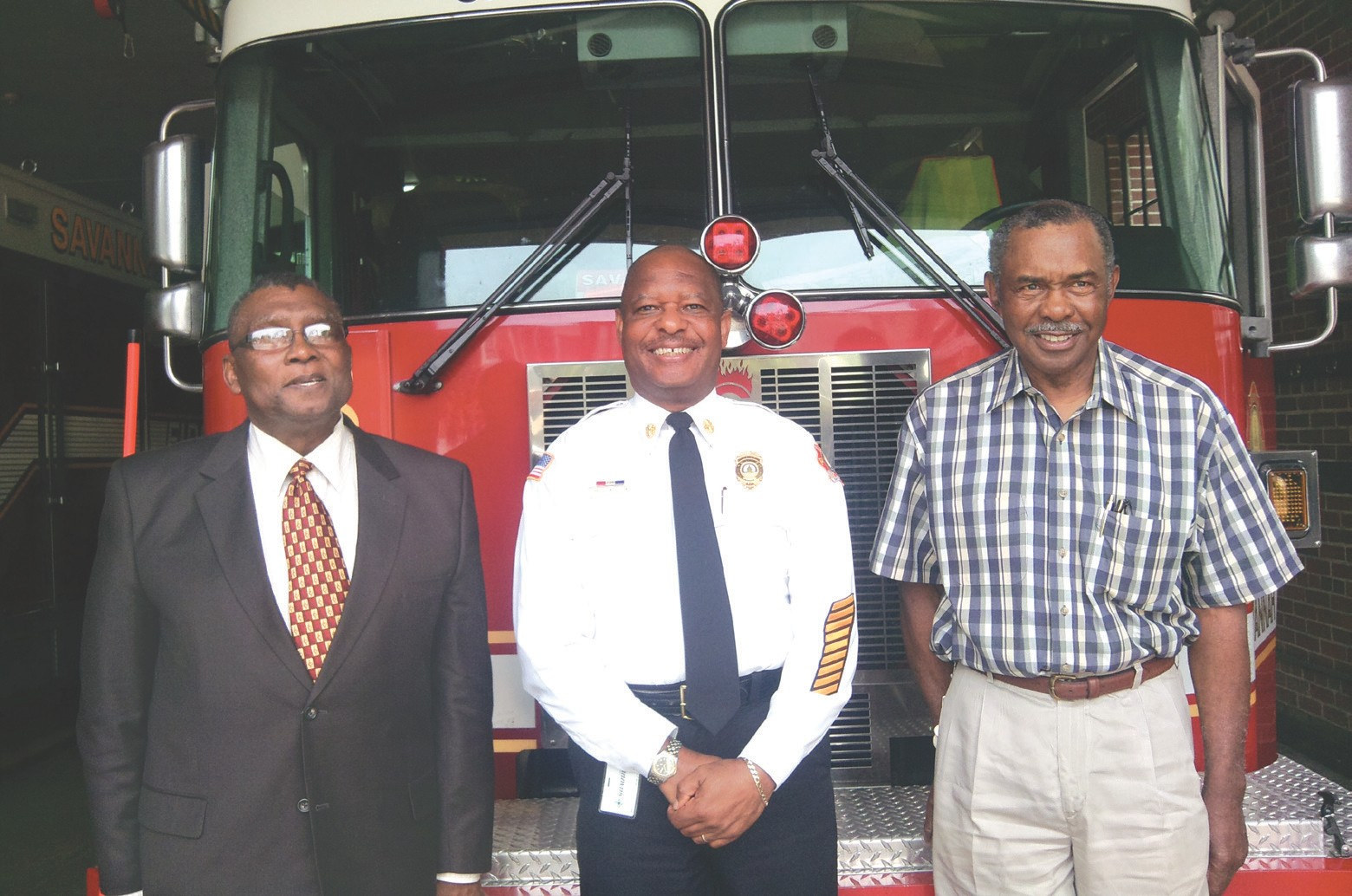Purdy Bowers, (left) and Lewis Oliver (right) were among six black men hired by the Savannah Fire Department on May 1, 1963. Chief Charles Middleton (center) is the 2nd black Fire Chief following Paul Taylor who was first.