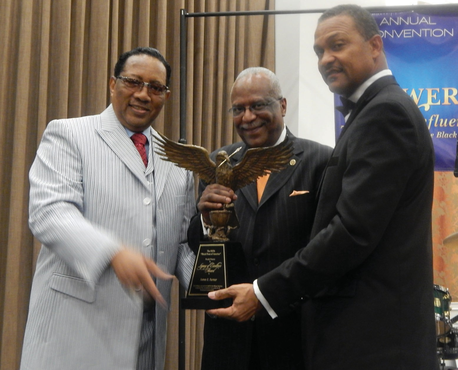 Ambassador Dr. Bobby Jones (left) Presents Legacy Award to Jim Farmer( center).