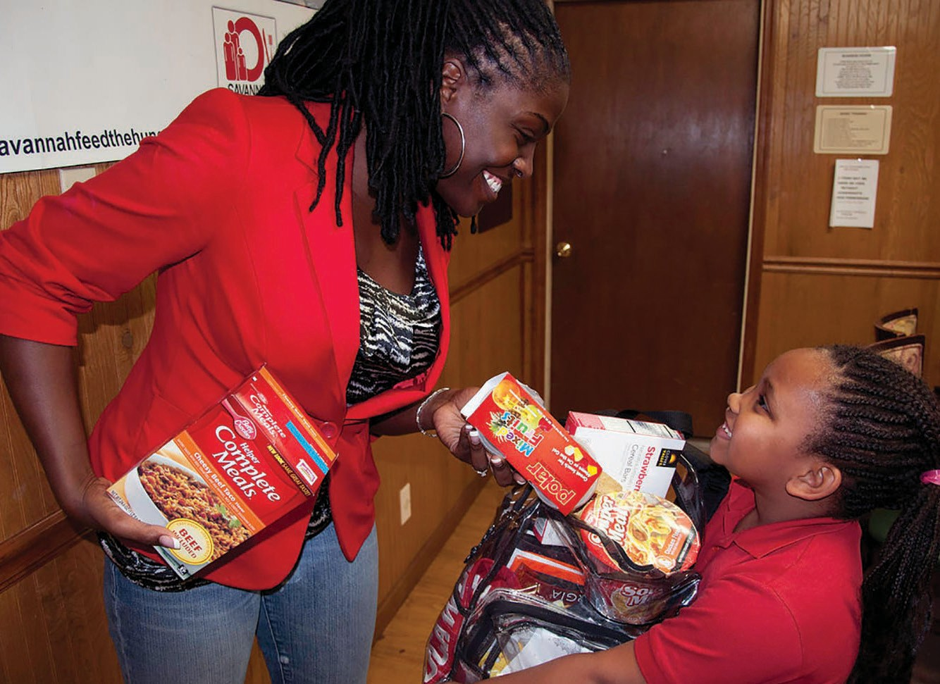Lady Mahogany of 94.1 the Beat and Love 101.1 giving back to children in the community.