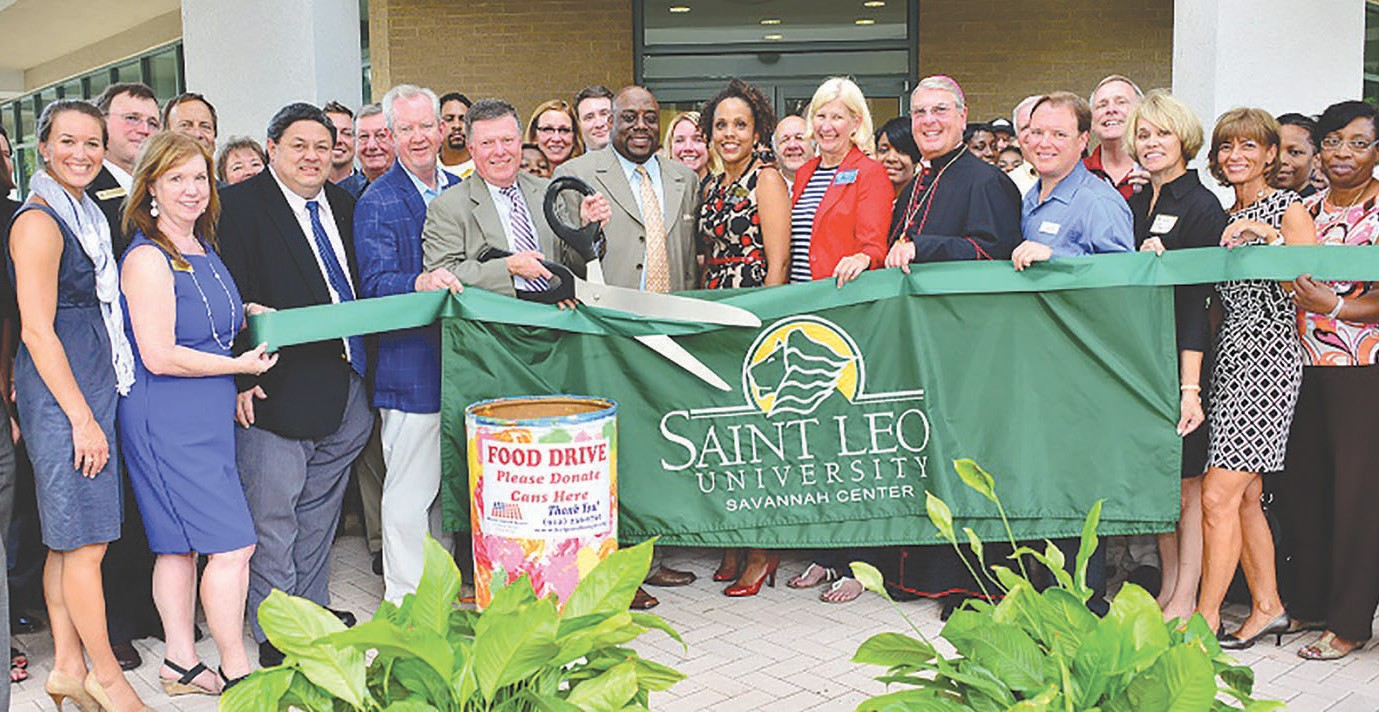 Dignitaries celebrate with ribbon cutting
