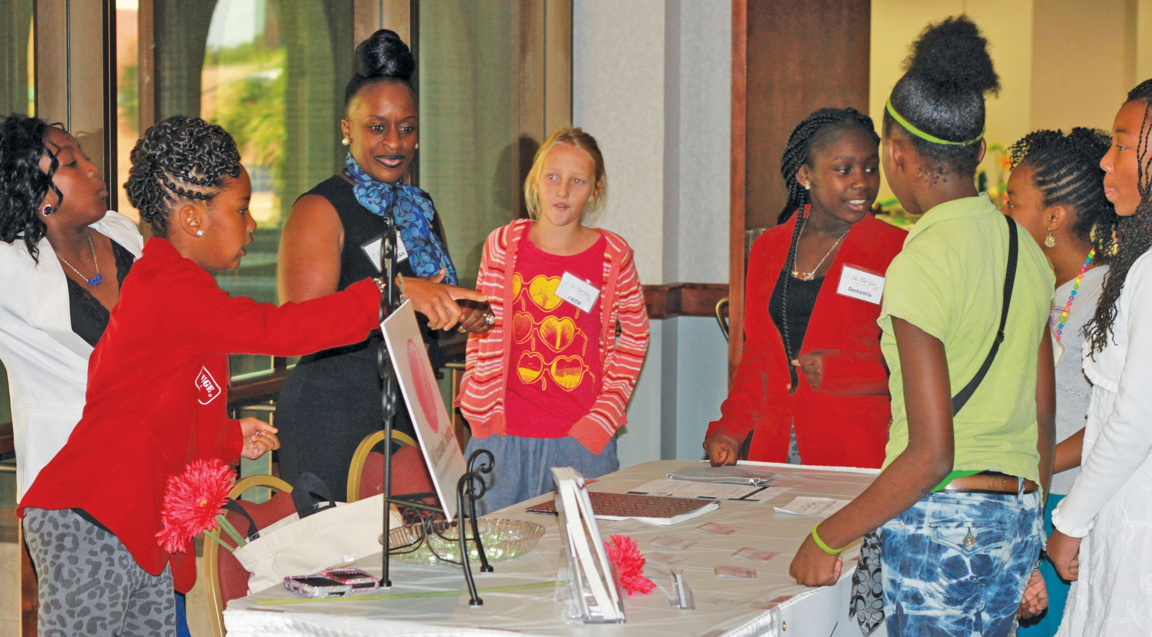 Reeshemah Johnson of All Occasions Consulting shown with young ladies attending conference