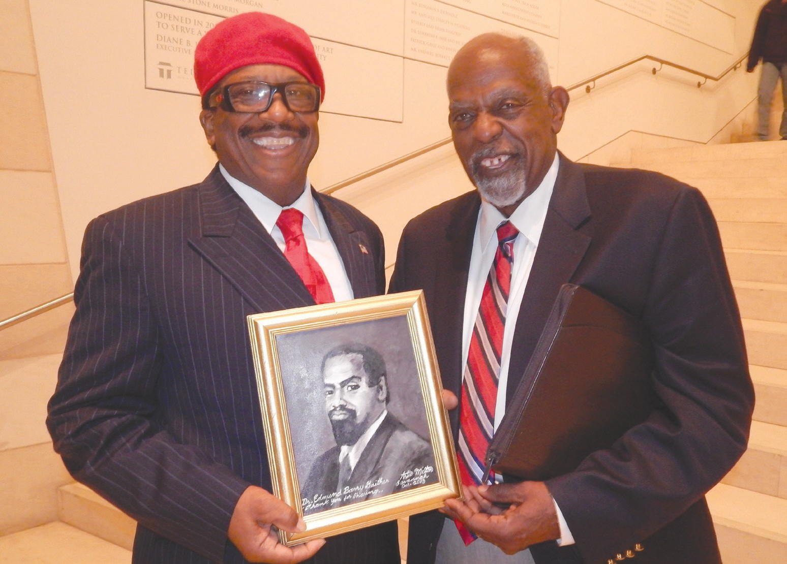"Savannah native Artie ""The Artist"" Milton presented Dr. Edmund Barry Gaither with a portrait painting of a younger Dr. Gaither."