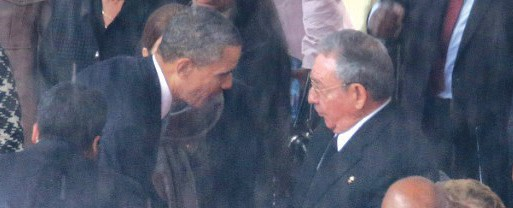 Obama shakes hands with Cuban President Raul Castro Photo Credit: Chip Somodevilla