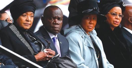 Mandela's ex-wife, Winnie Madikizela-Mandela, left, and his widow, Graca Machel, right, sit near each other during the memorial service Photo Credit: Matt Dunham/AP