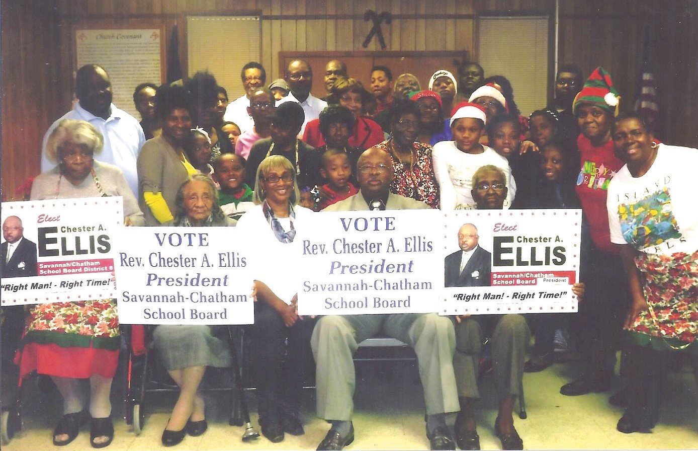 Rev. Chester Ellis (center) surrounded by supporters