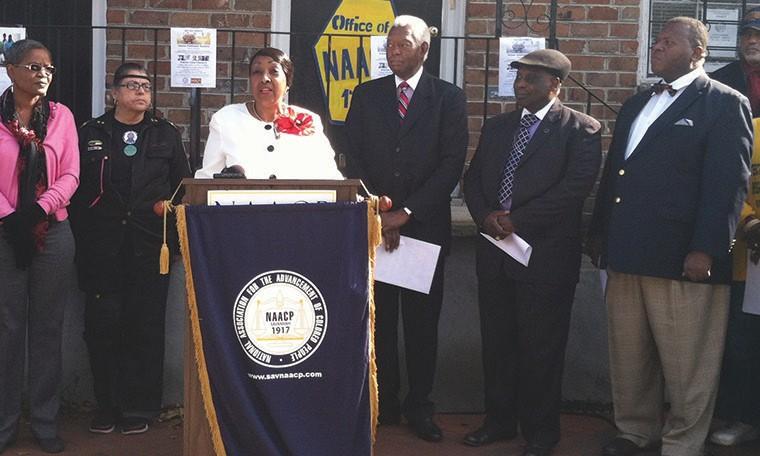 (l-r) From podium Mayor Edna B. Jackson, Richard Shinhoster, Bishop Willie Ferrell and Commissioner Yusef Shabazz.