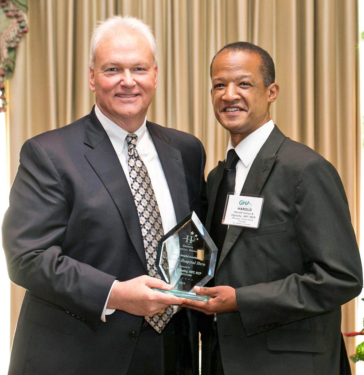 GHA President Earl Rogers (L) and St. Joseph's/Candler's Harold Oglesby (R)