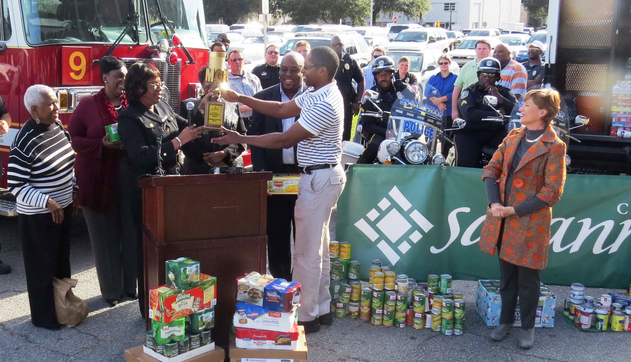 City of Savannah employees make presentation to Mary Jane Couch, of America's Second Harvest