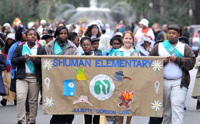Girl Scouts from Shuman Elementary march in the Georgia Day Parade