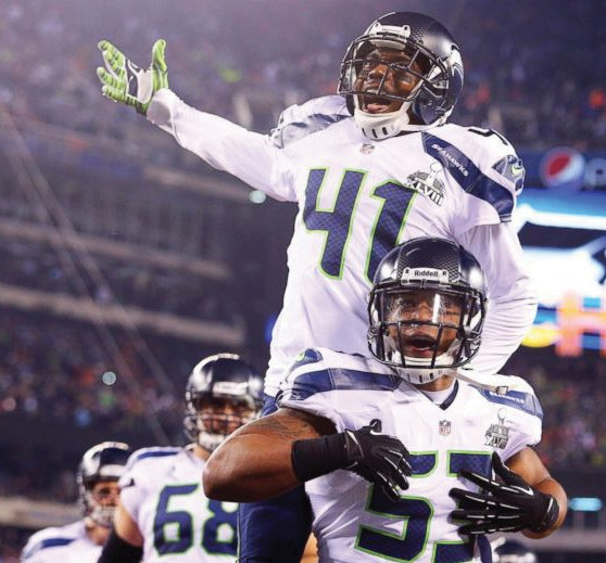 Seattle Seahawks outside linebacker Malcolm Smith (53) and cornerback Byron Maxwell (41) celebrate a touchdown during the first half against the Denver Broncos in Super Bowl XLVIII at MetLife Stadium.