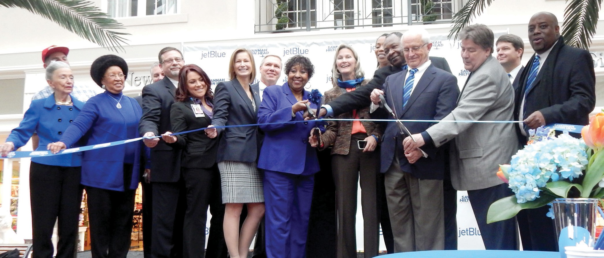 JetBlue officials along with Mayor Edna Jackson, Airport Commissioners and other dignitaries cut the ribbon in celebration of JetBlue adding flights to Savannah.