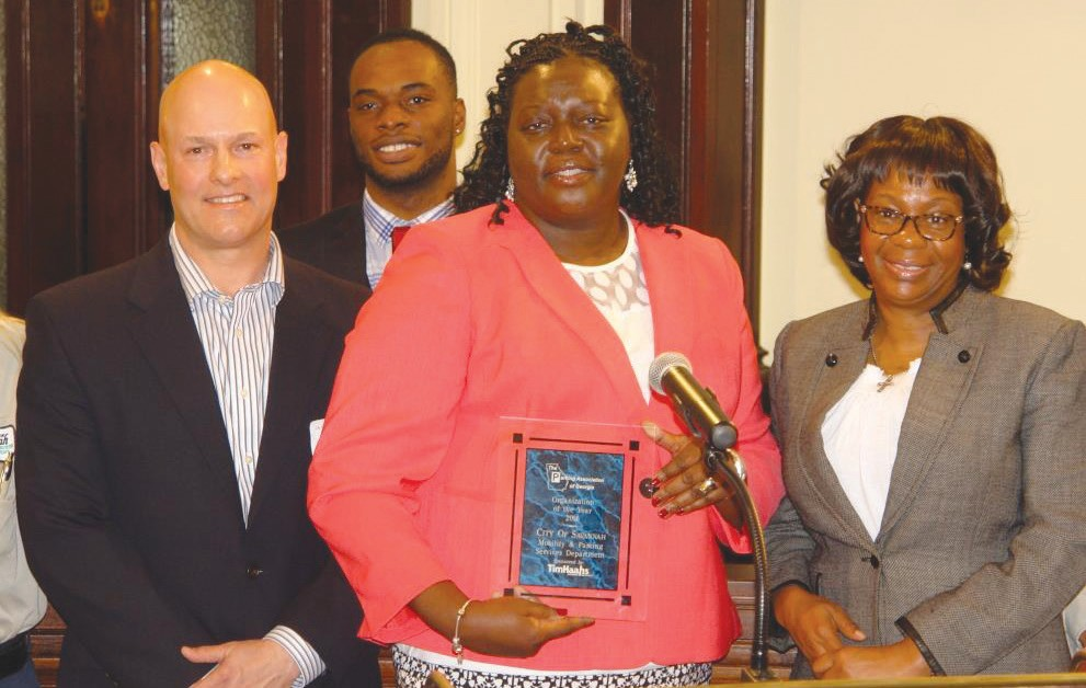 From left: Parking Association of Georgia President Don Walter; Mobility and Parking Services Analyst Dominic Ross and President Veleeta McDonald; and Savannah City Manager Stephanie Cutter receive the Organization of the Year award from the Parking Association of Georgia.