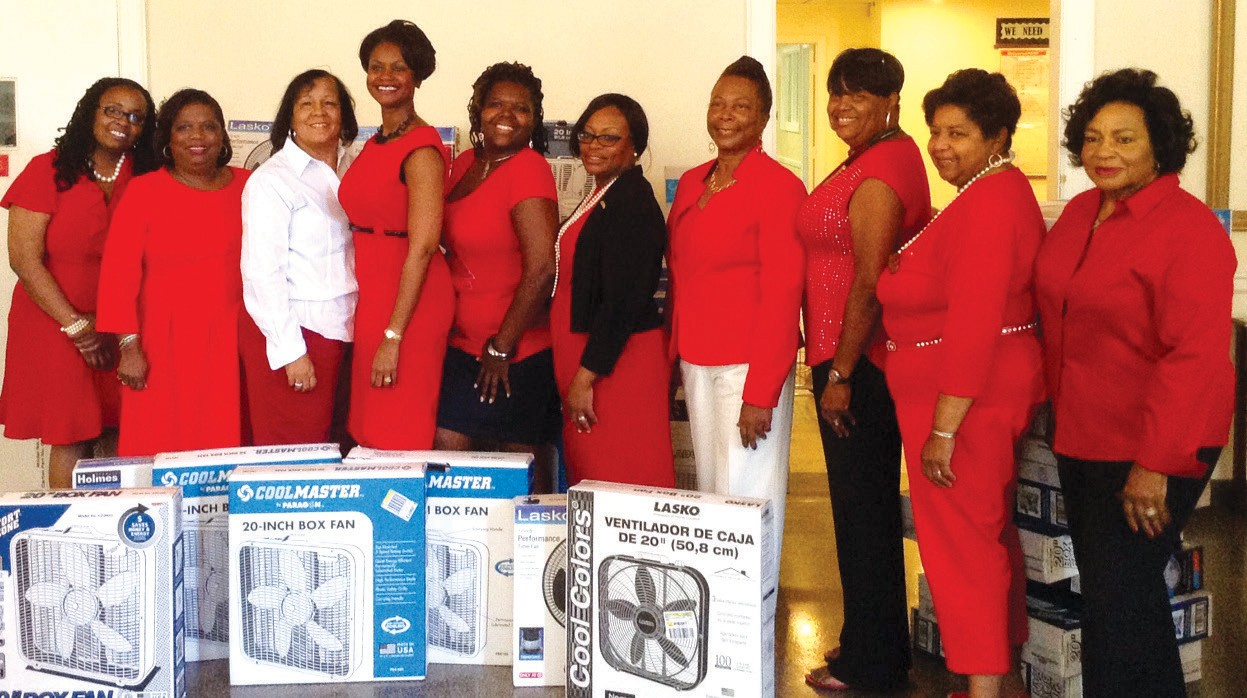 Chapter members present 70 electric fans to Senior Citizens, Inc.