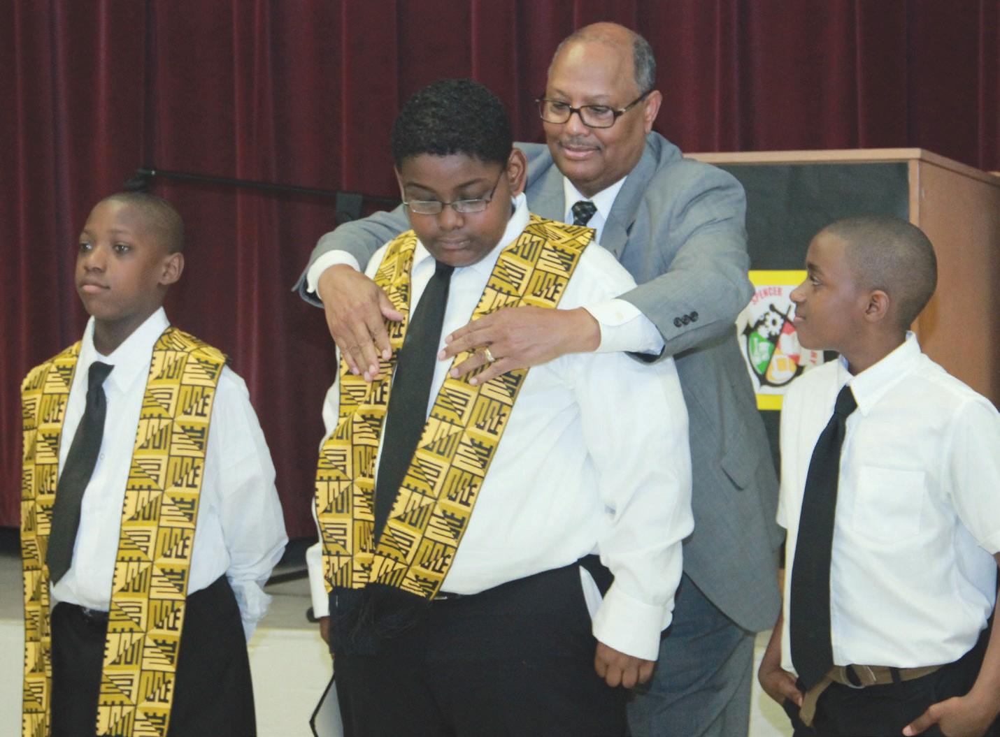Fifth graders receiving their Kente Shawls