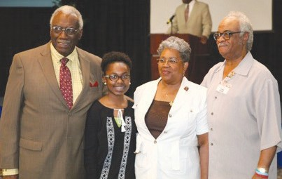 The recipient of the Rev. Bennie R. Mitchell, Jr. Memorial Scholarship, Winter Beaton with (l. to r.) Deacon Louis Fair, Chairman of the Scholarship Board; Mrs. Betty T. Mitchell and State Representative Tyrone Brooks, GABEO president (Not Shown: Dr. Blenda Wilson, Chairman of the Scholarship Board).