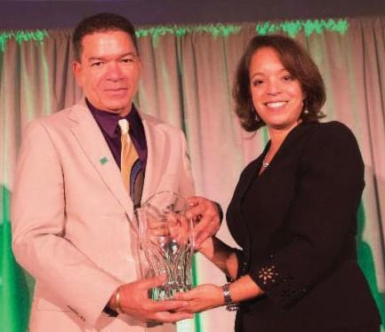 NBA President Michael Grant receiving award from MBDA National Director Alejandra Y. Castillo.