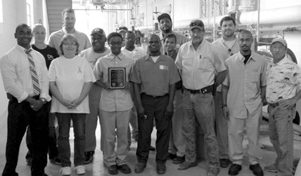 "Employees from the City of Savannah I & D Plant pose with the ""Best of the Best Taste"" award, recognizing Savannah's drinking water as the best-tasting in Georgia."