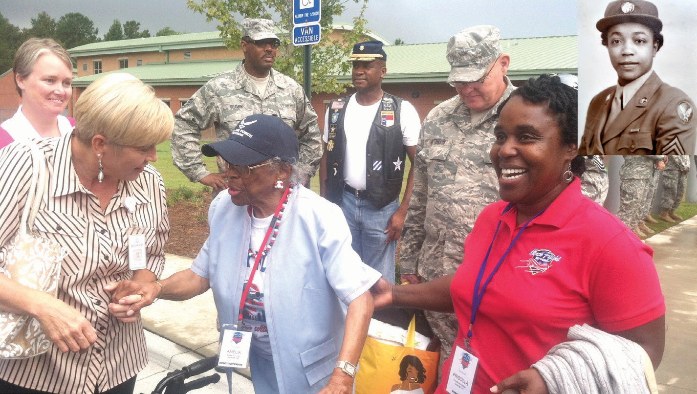 Pictured in the send-off picture is Mrs. Amelia Jones. To her left is her Hospice Savannah volunteer, and Honor Flight Guardian Priscilla Walker.