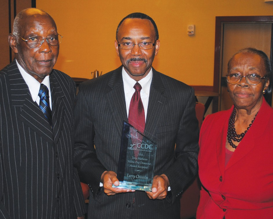 Attorney Larry Chisolm (center) poses with parents.